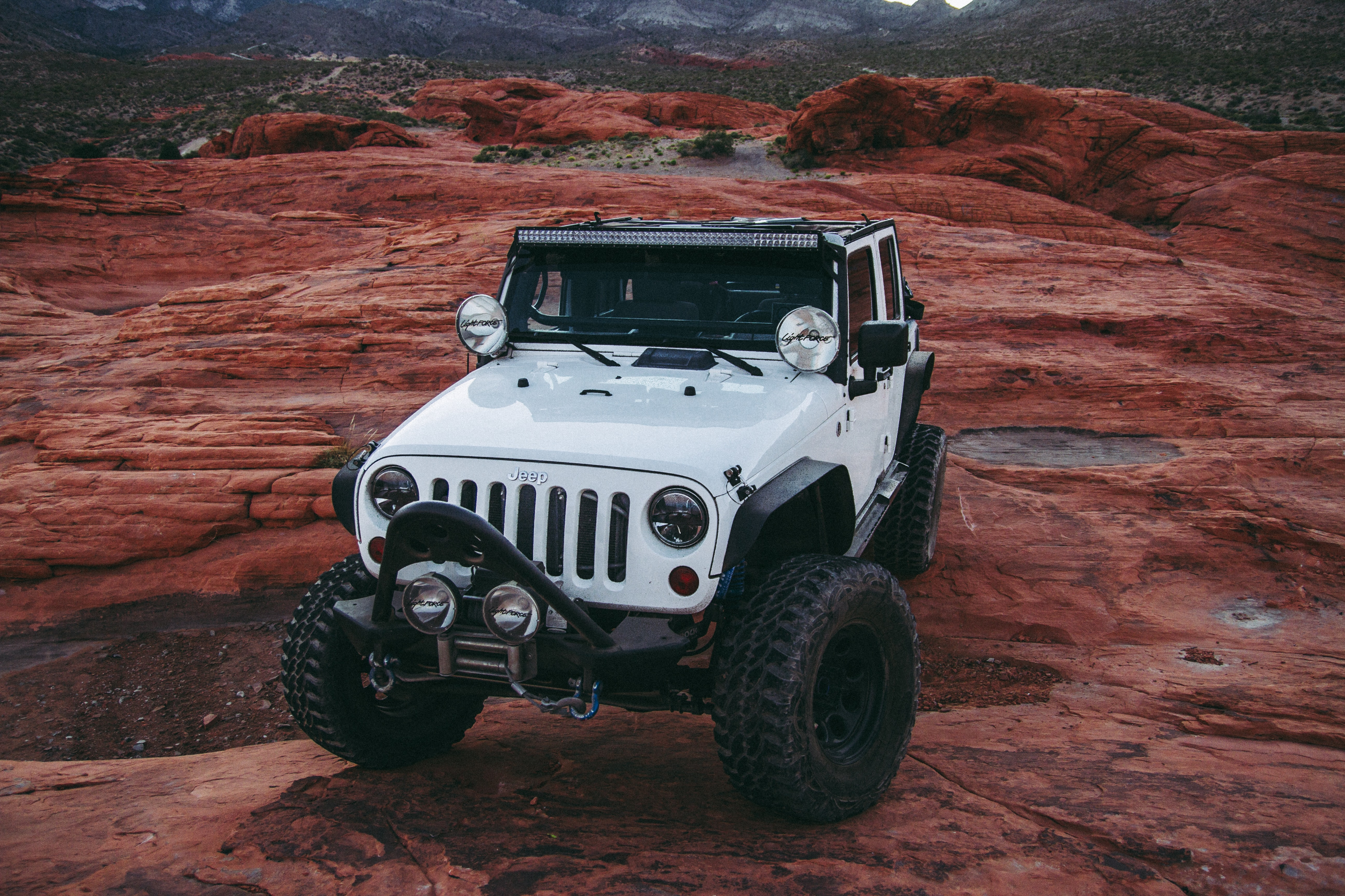 white Jeep Wrangler on land