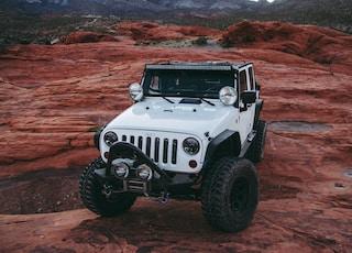 white Jeep Wrangler on land