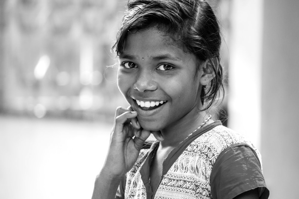 grayscale photography of smiling girl