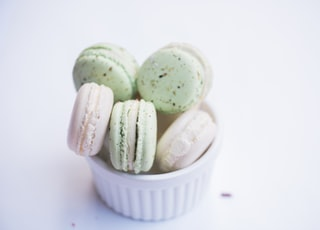 ramiken of macarons on white surface