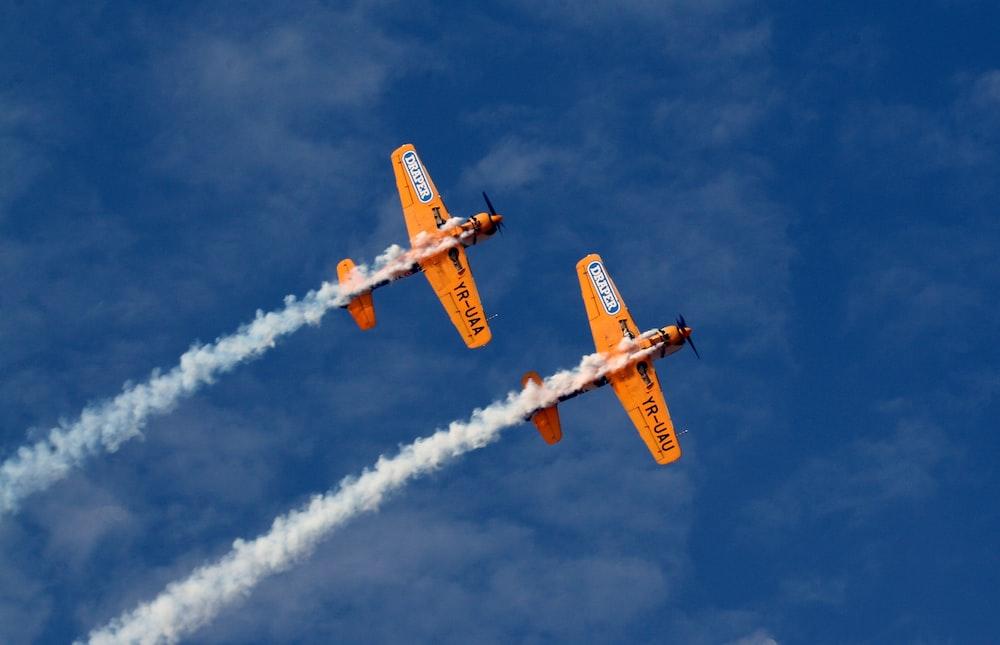 two orange jet planes