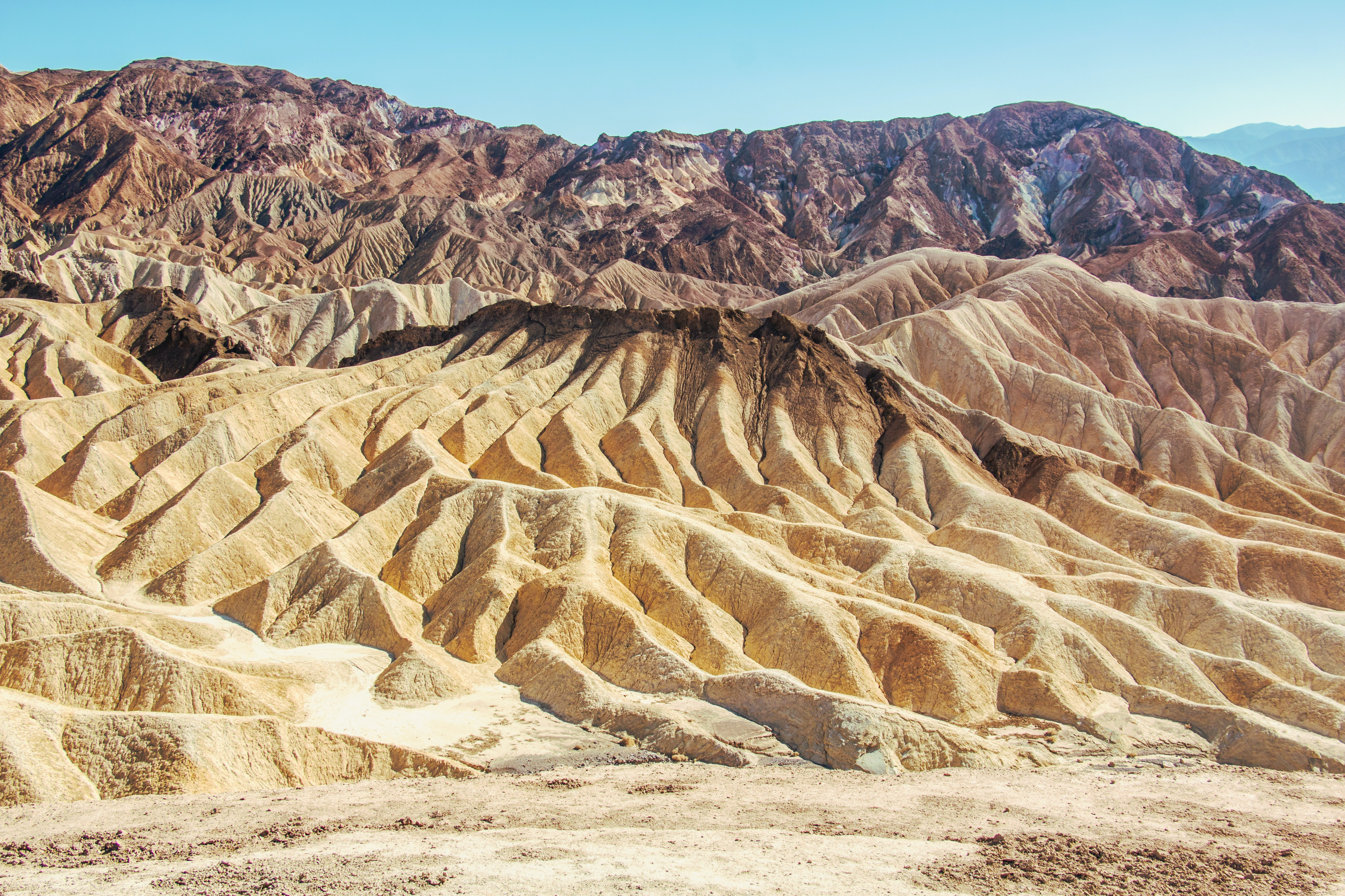 Natural rock formations in the desert sand of Death Valley