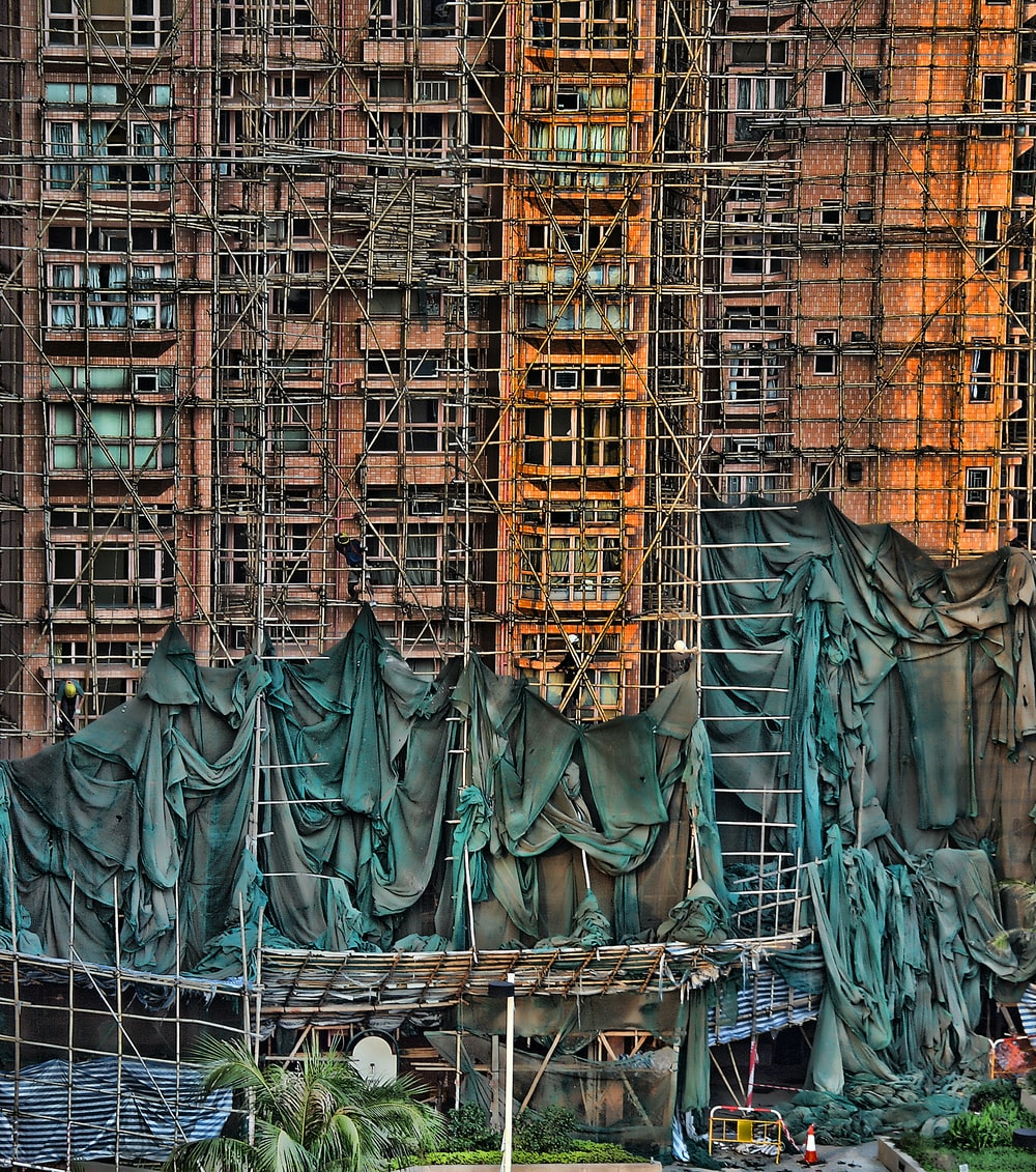 under construction building with scaffoldings