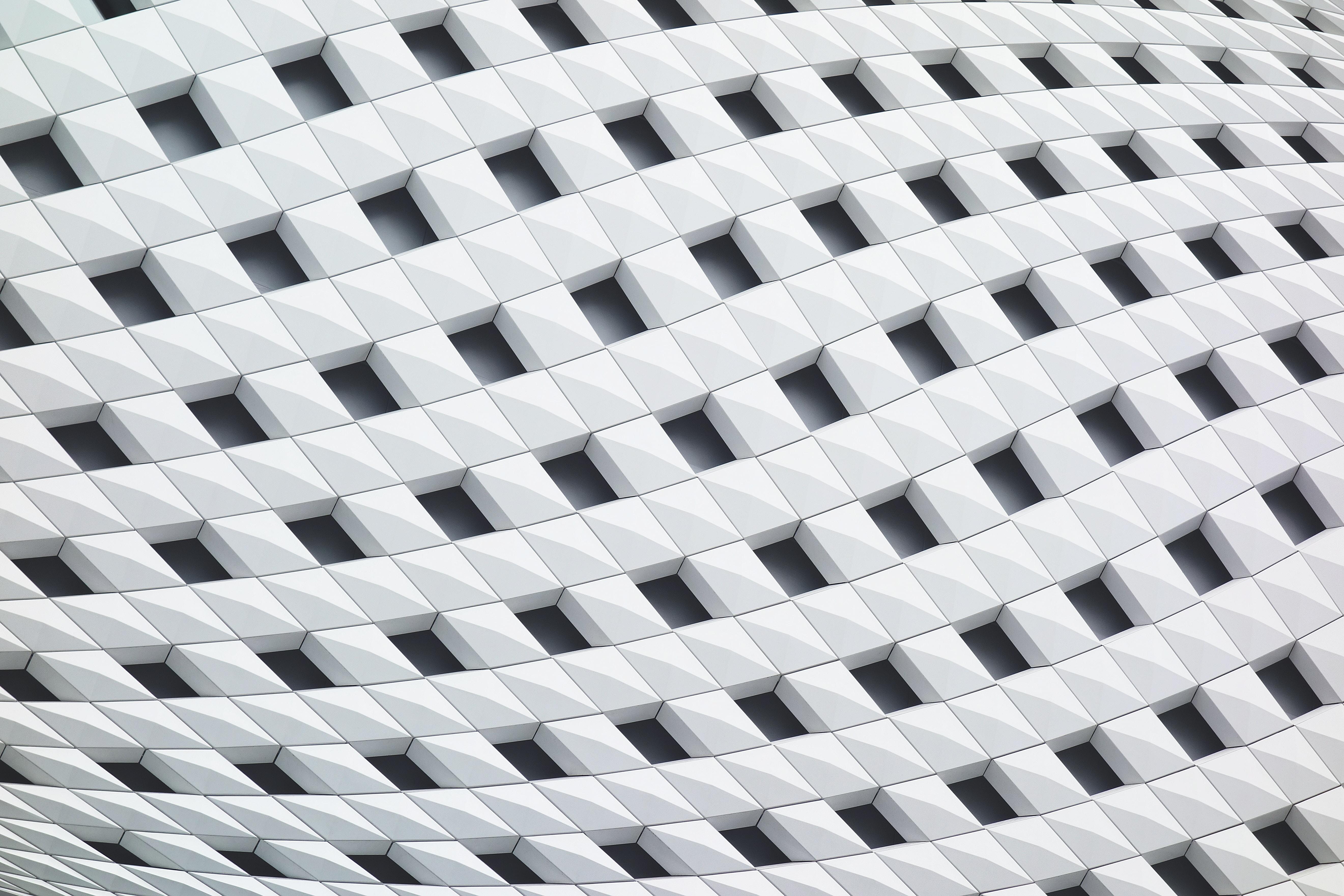A curving facade with a latticework of white tiles