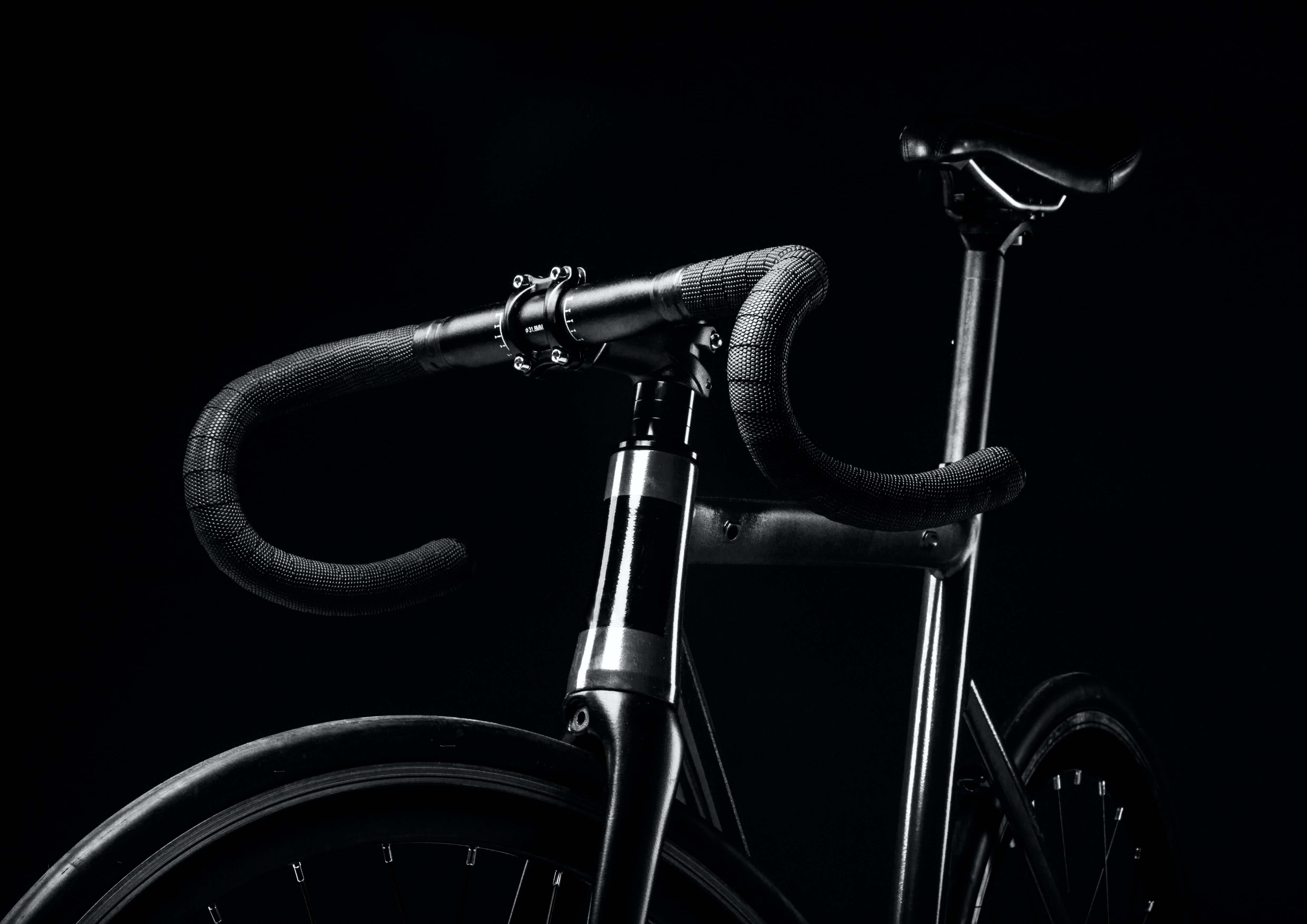 A black-and-white shot of a road bicycle