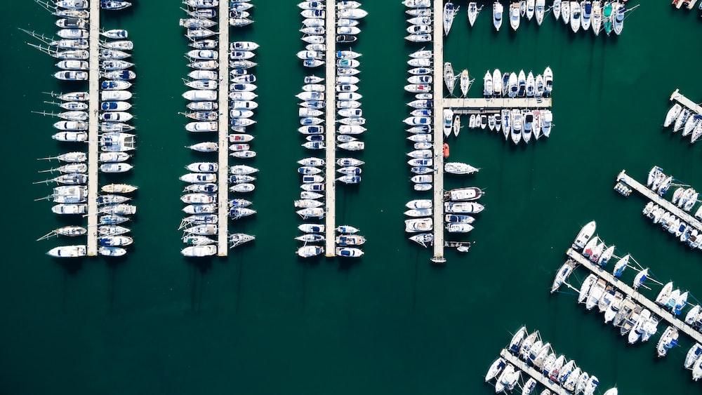 bird's eye view photo of yacht near dock
