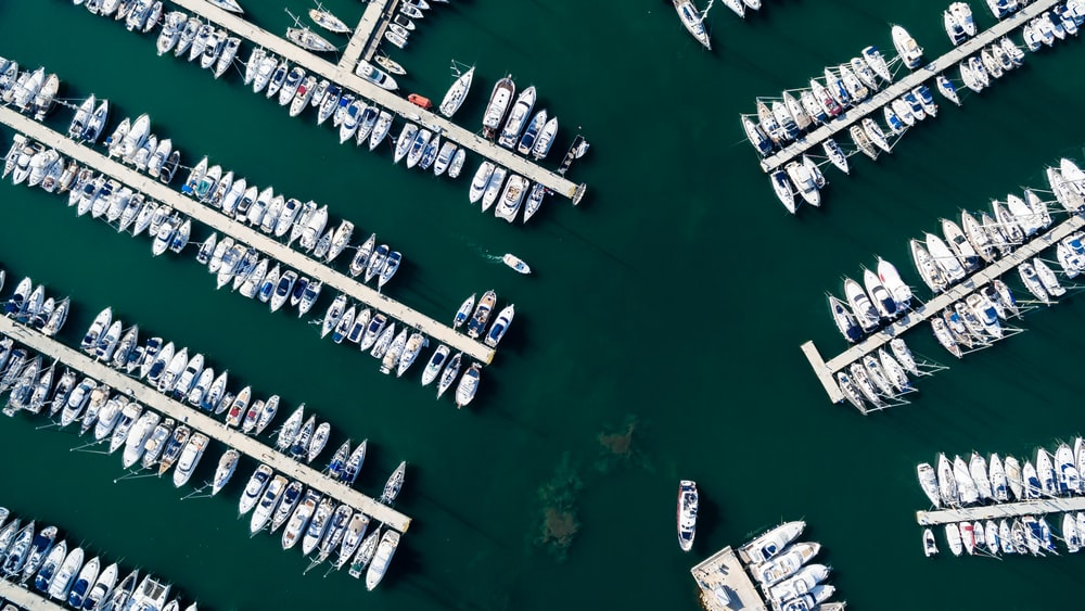 white boats on docking station