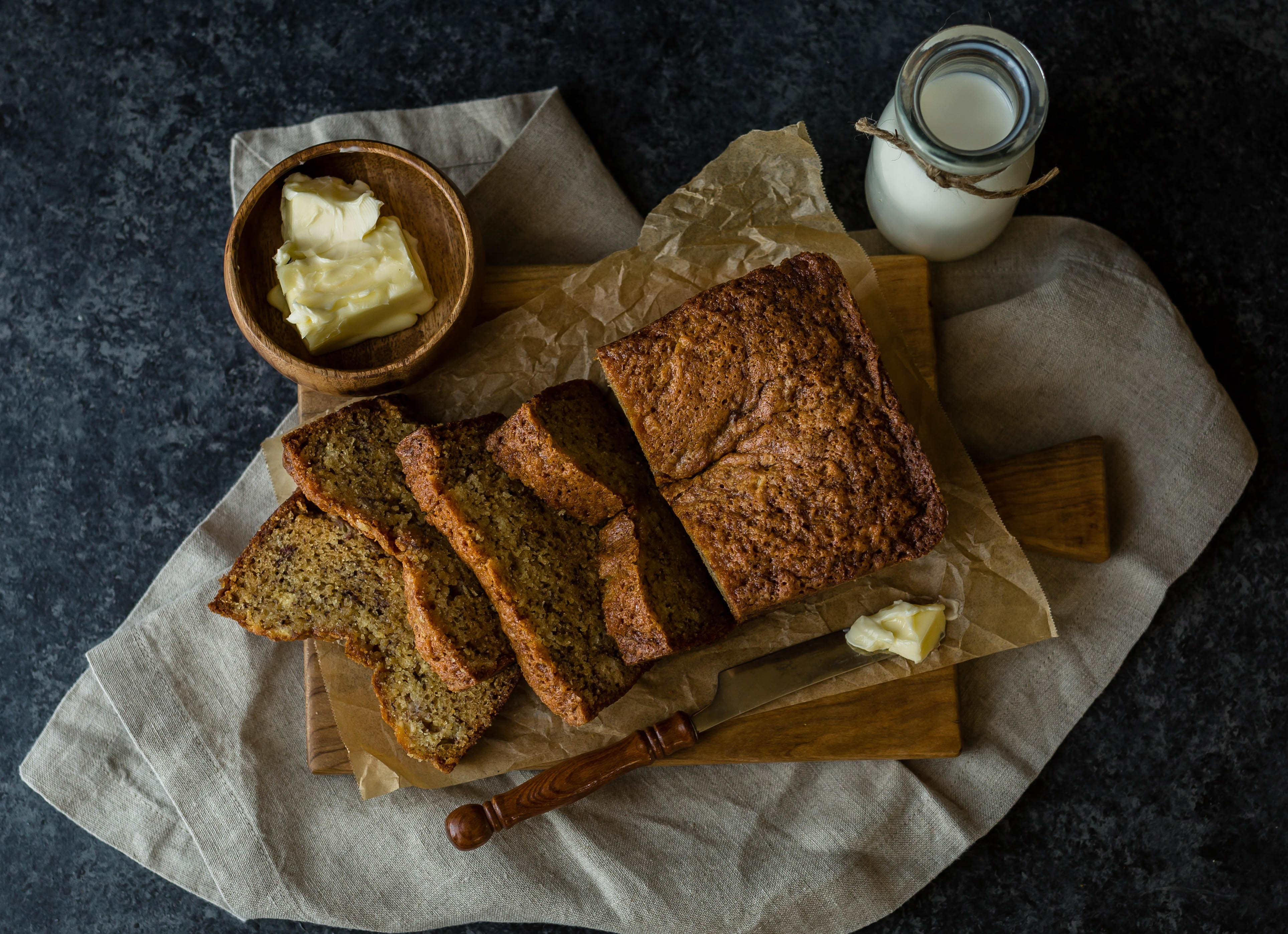 bread beside butter and milk