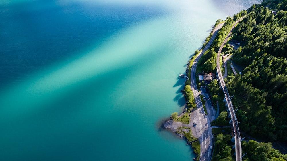 bird's eye view photography of road coastline