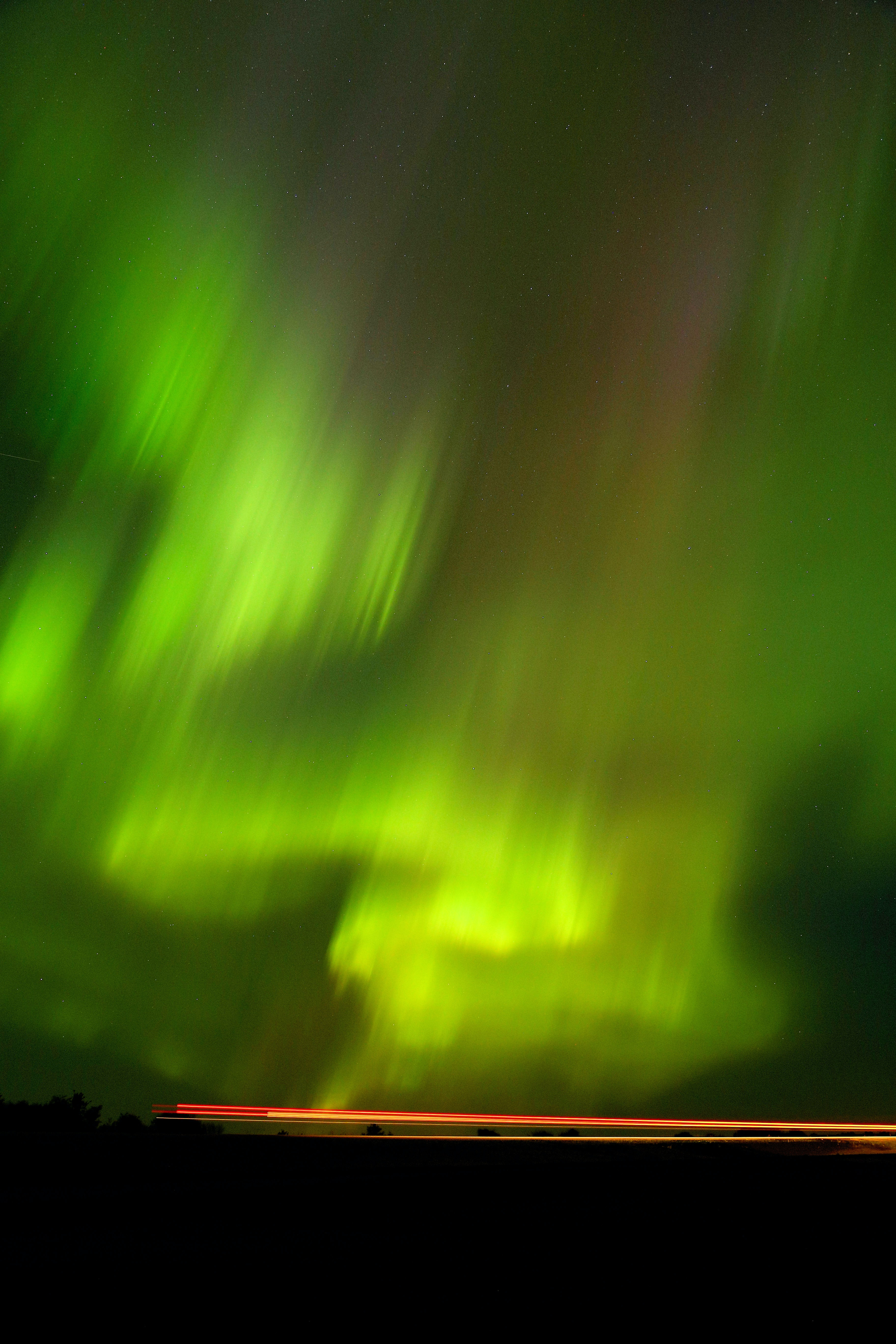 Bright and colorful Northern Lights filling up the entire sky over Saskatchewan