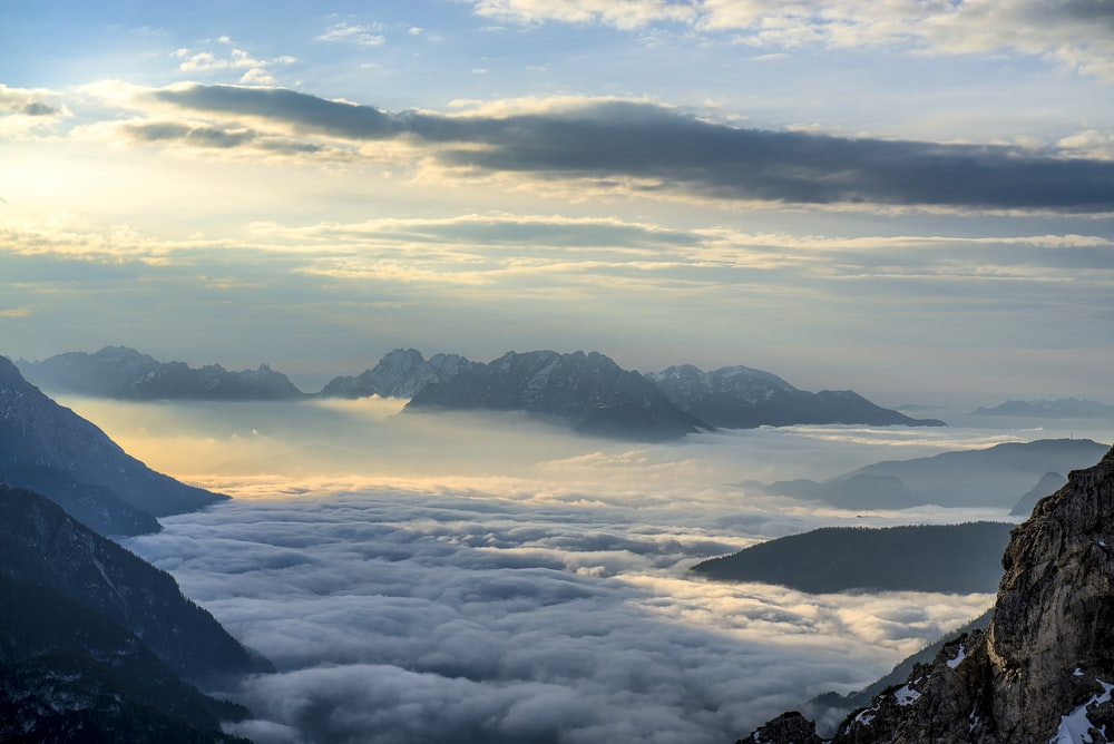 landscape photography of mountains surrounded with clouds