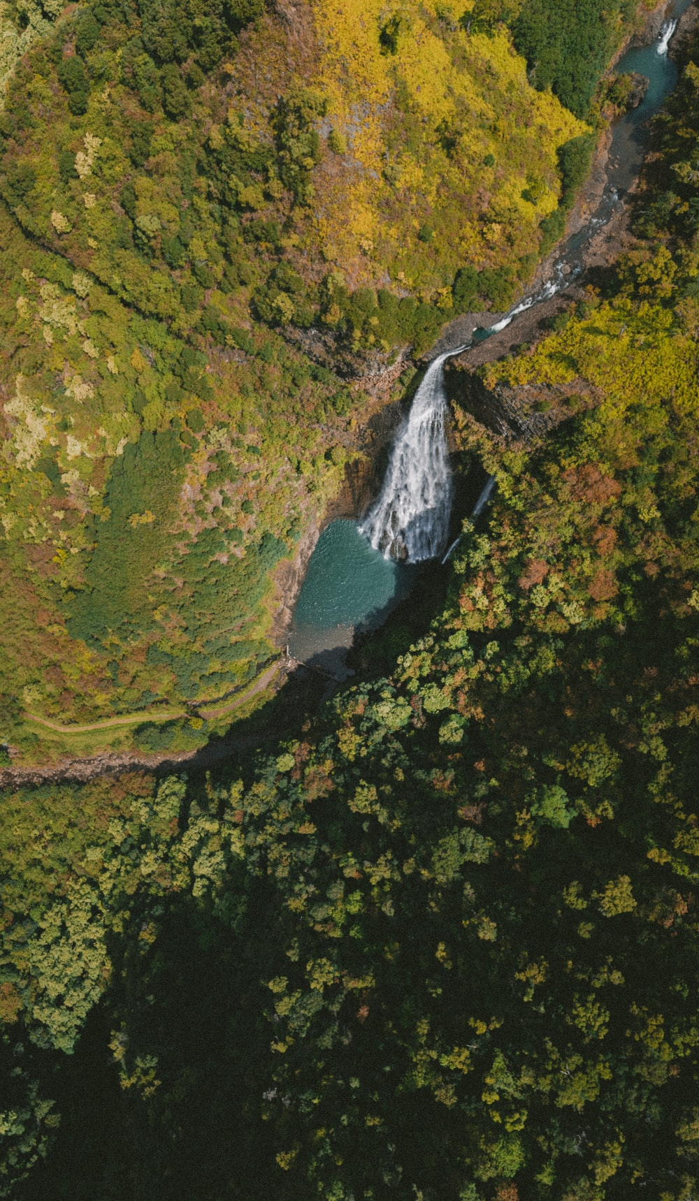 bird's eye view of flowing waterfalls between mountains