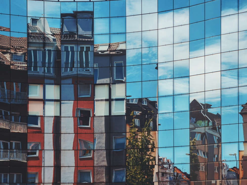 buildings reflection on glass building