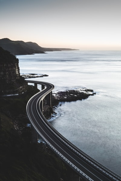 Sea Cliff Bridge is located in Sydney, Australia. I went out at 2am to a cliffside lookout to capture the sun rising with the bridge in view.