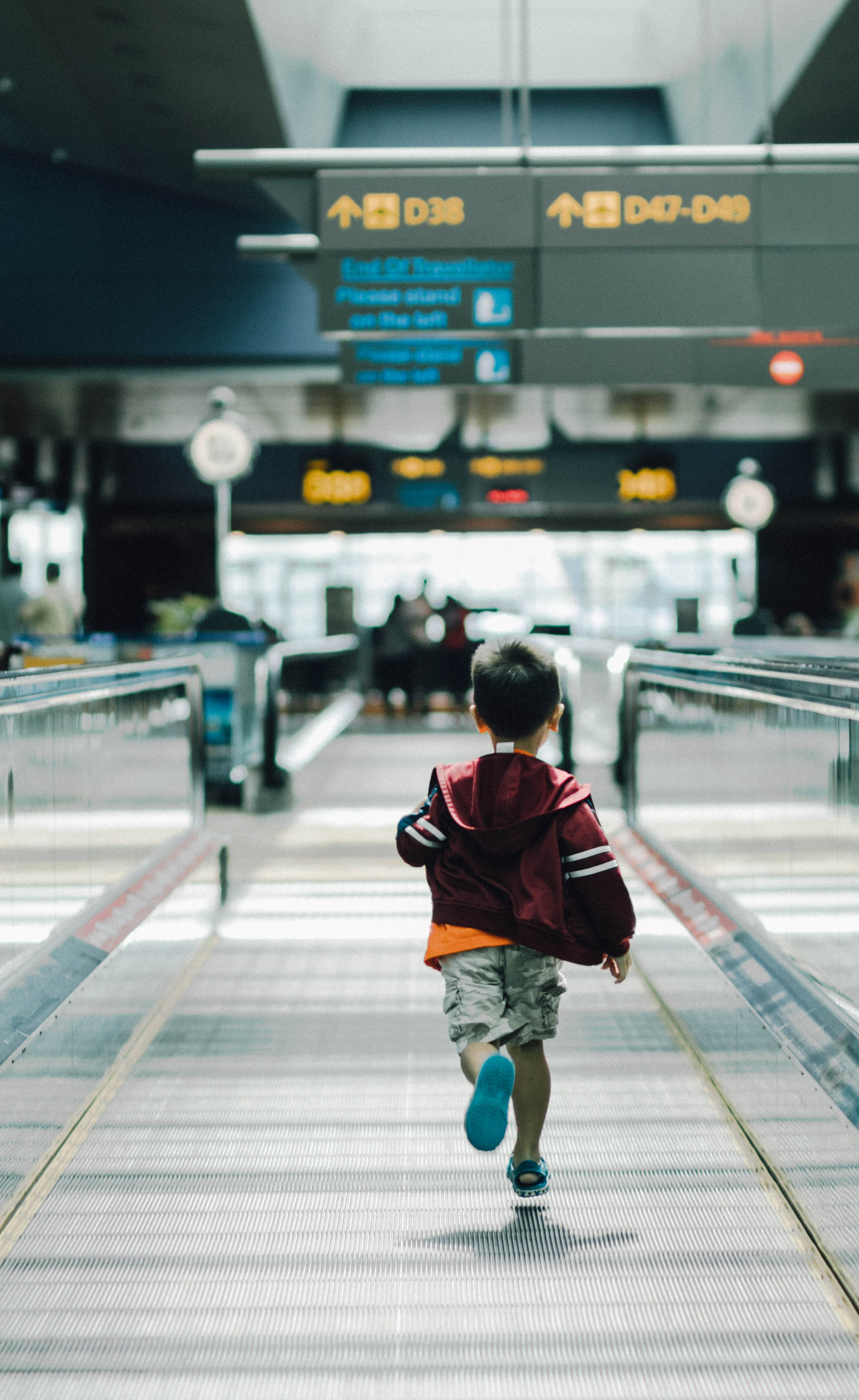 A small boy running at the airport