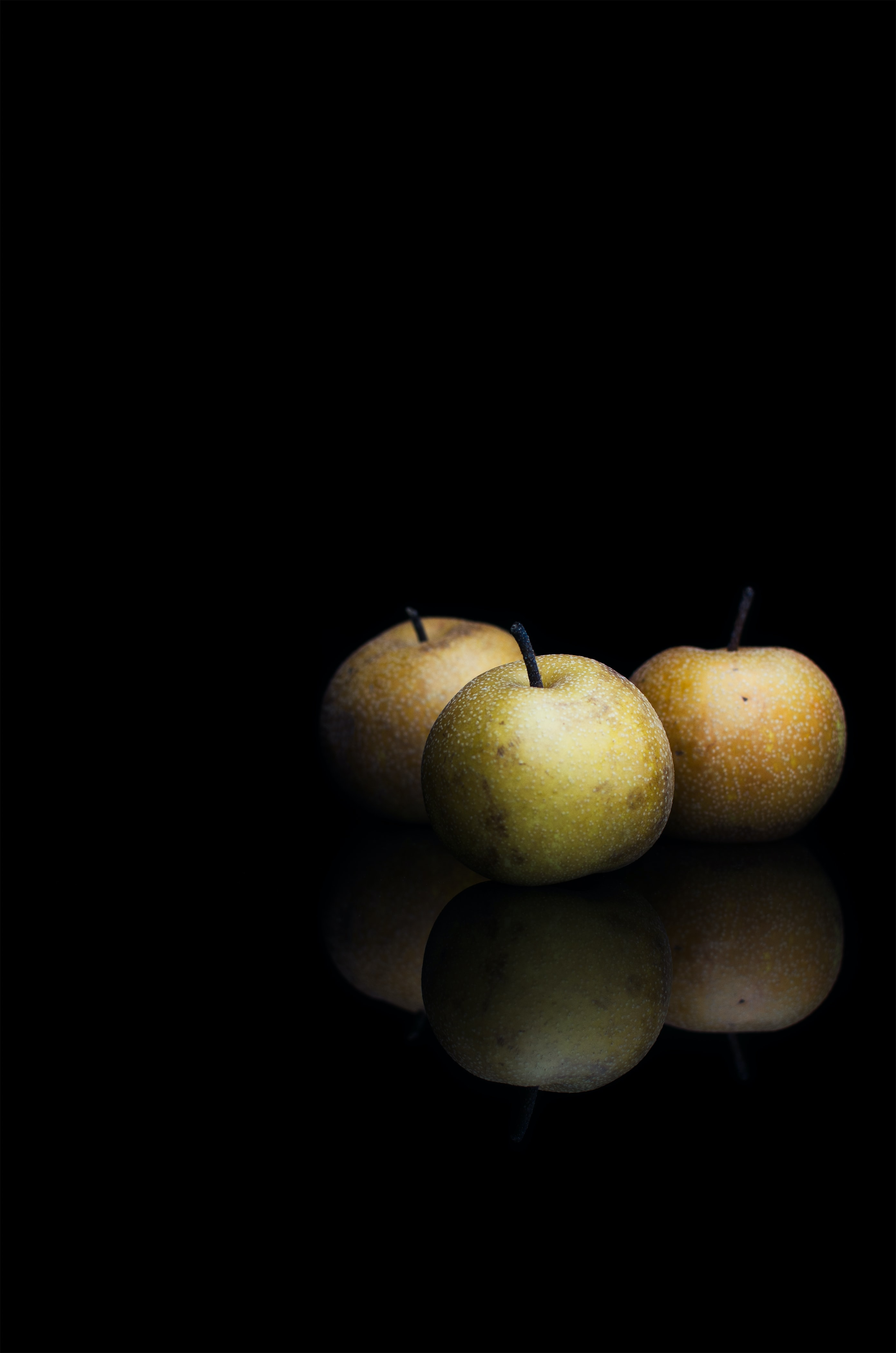 round fruits in dimmed area