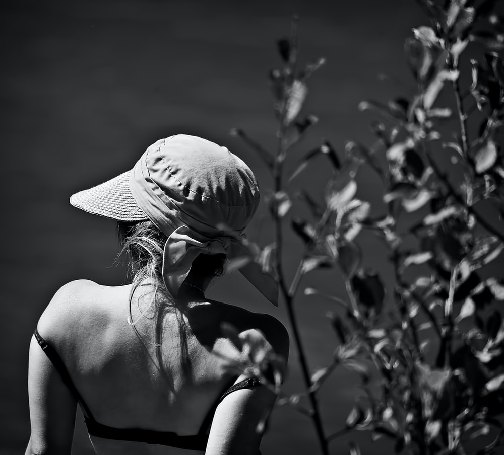 grayscale photography of woman wearing cap
