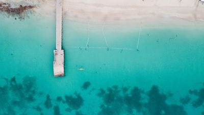 aerial view of dock surrounded by body of water