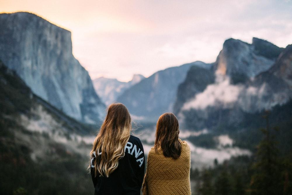 two women facing backwards