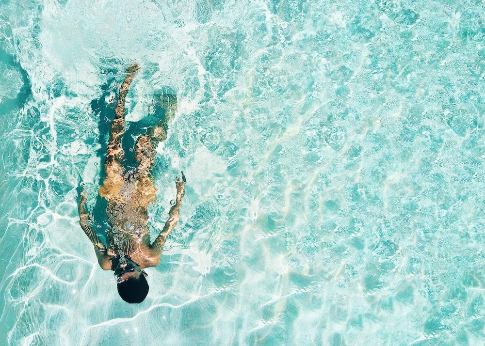 man snorkeling under water