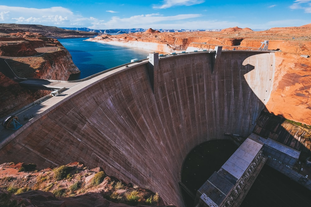 aerial photography of gray concrete water dam