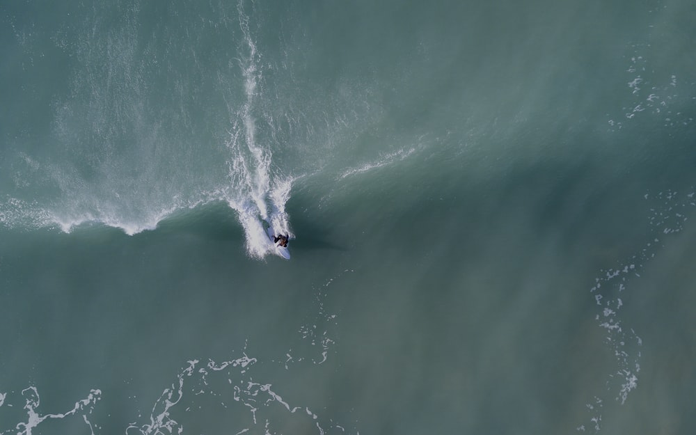 man surfing on the ocean wave