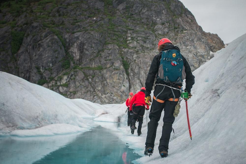people walking on white snow
