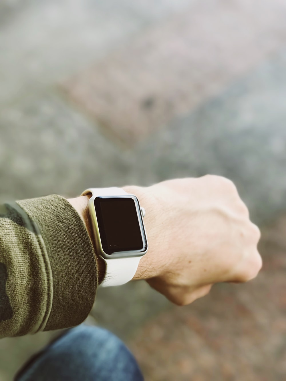 person wearing silver platinum Apple Watch and white Sport Band