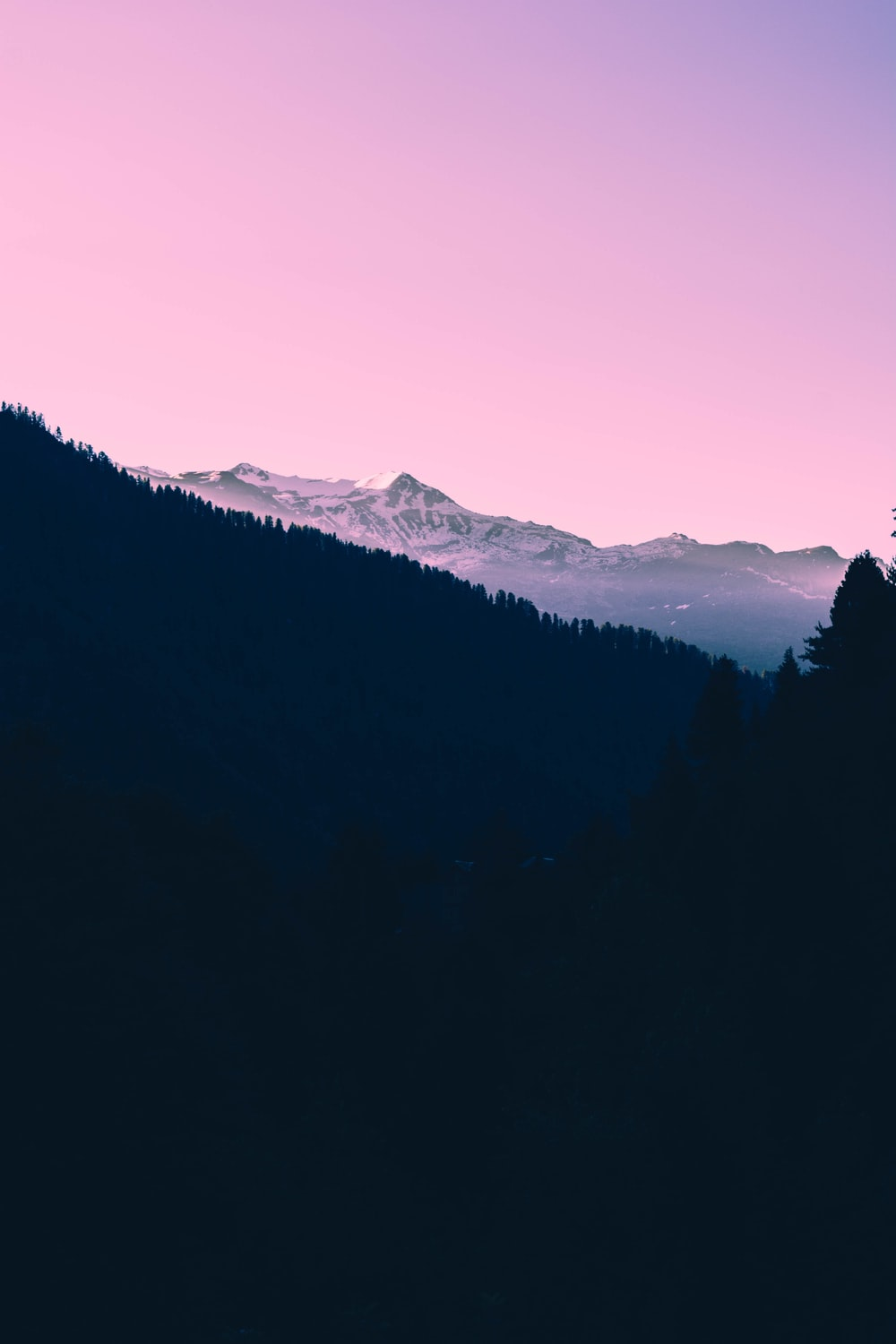 Tumblr background pictures download free images on unsplash a dark sunset over snow covered mountains and a pink sky voltagebd Gallery