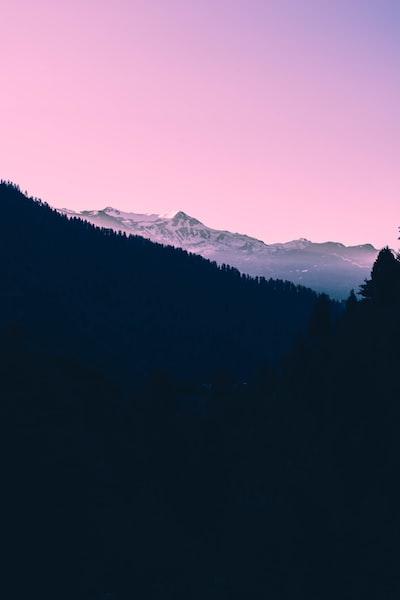 Dark sunset on snow covered mountain