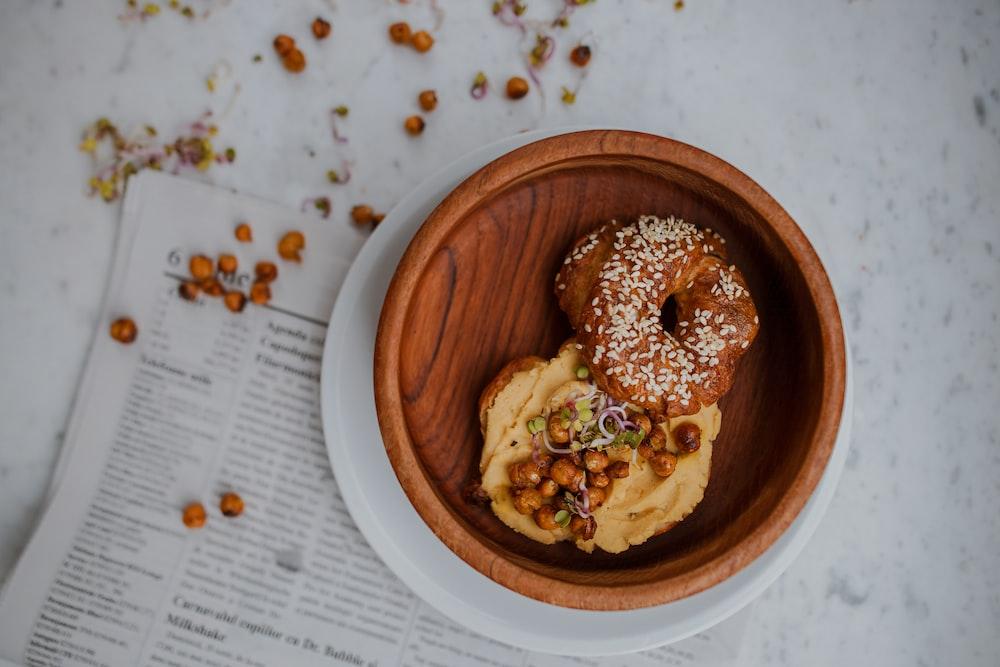 doughnut in round brown wooden tray