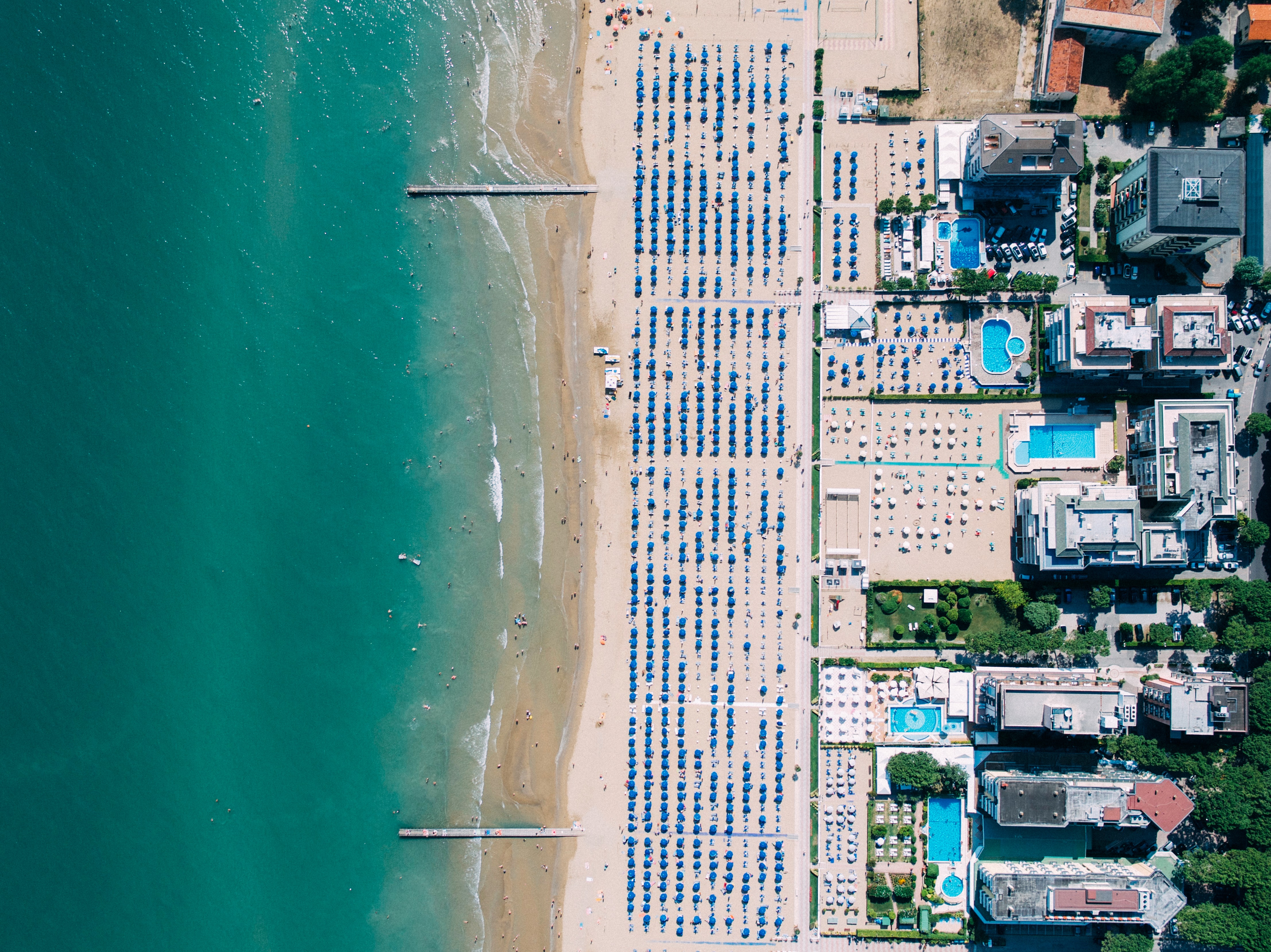 Drone aerial view of coastal resorts and an ocean sand beach in Lido di Jesolo