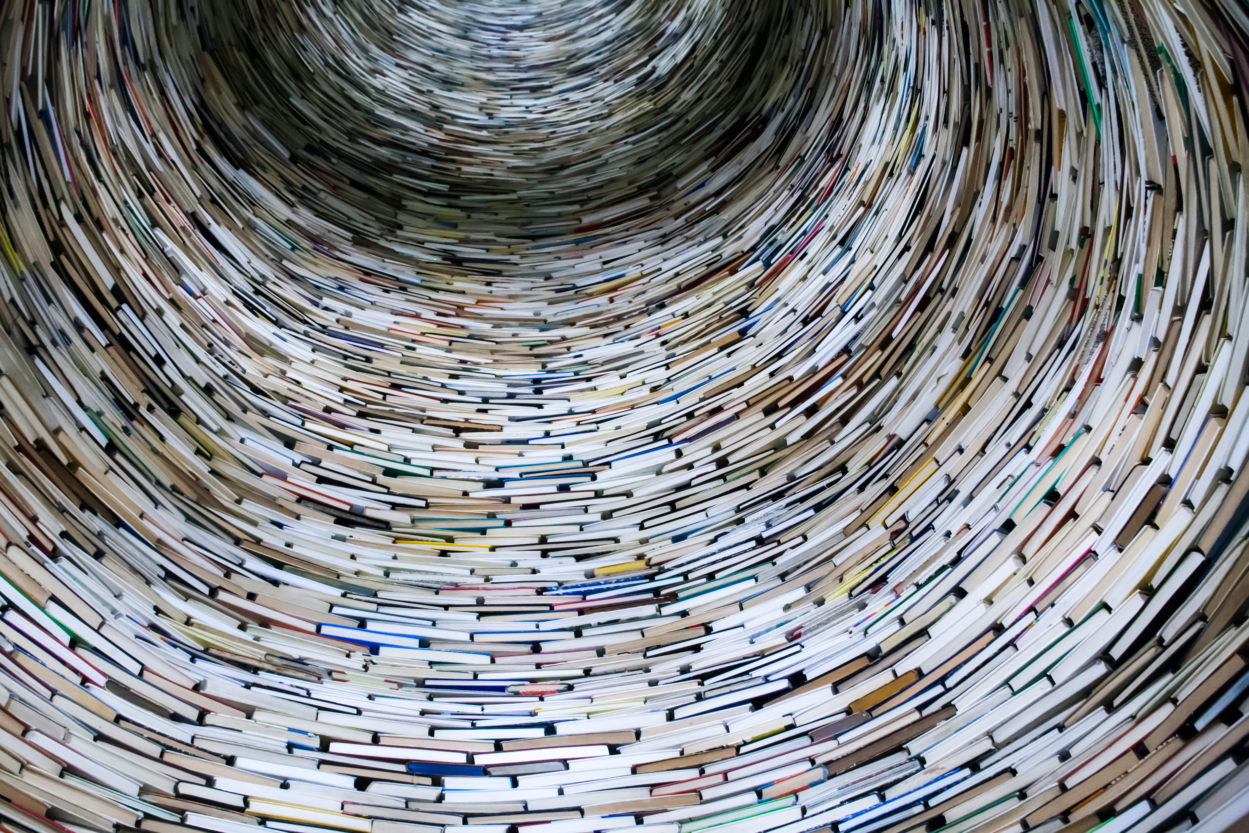 A round circle made up of books, looking like a tunnel