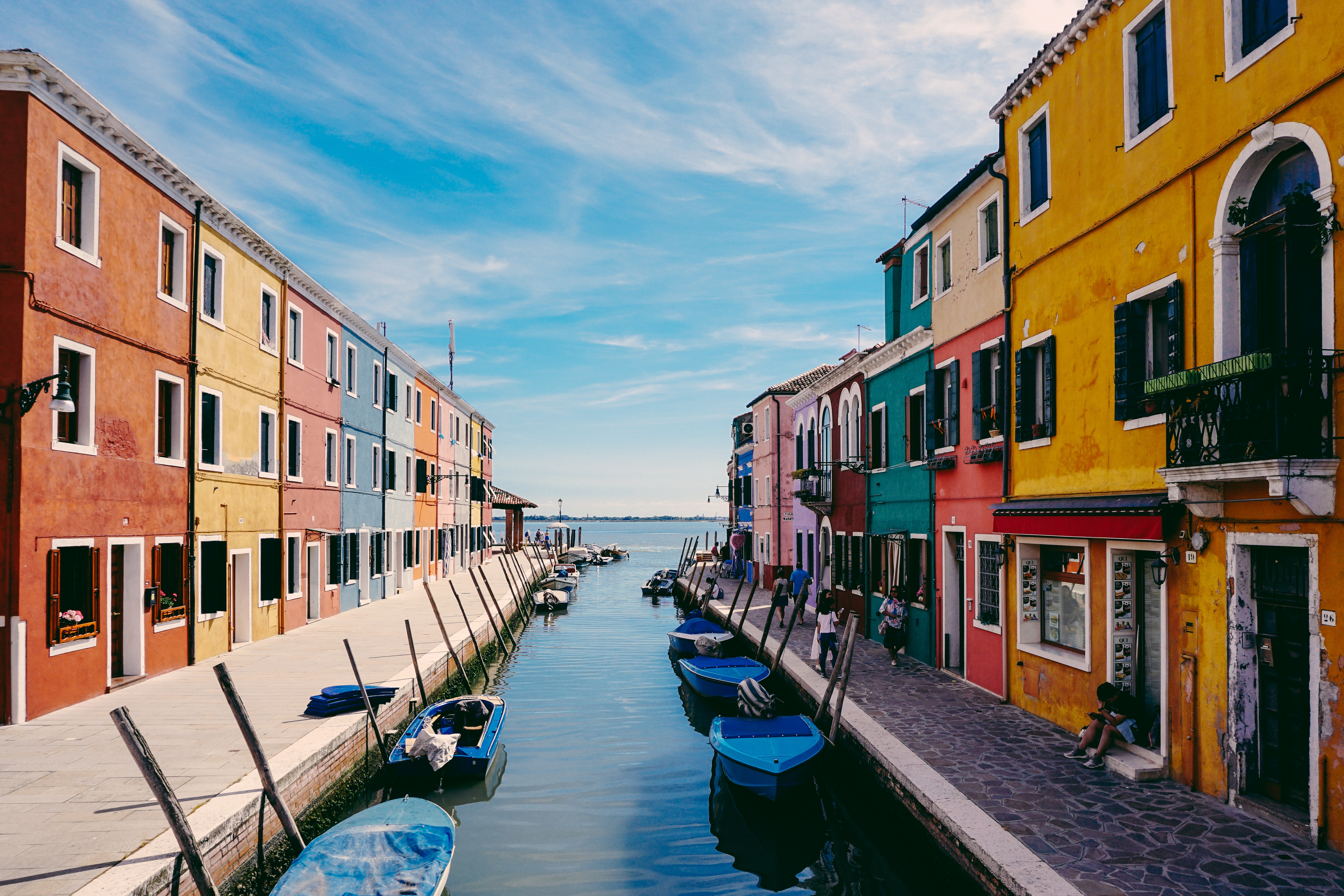An city canal lined with colorful houses in Burano