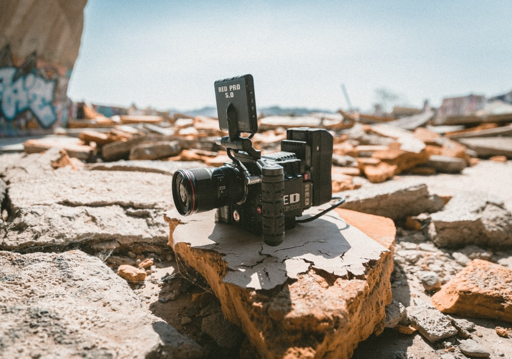 black camera on gray and brown stone