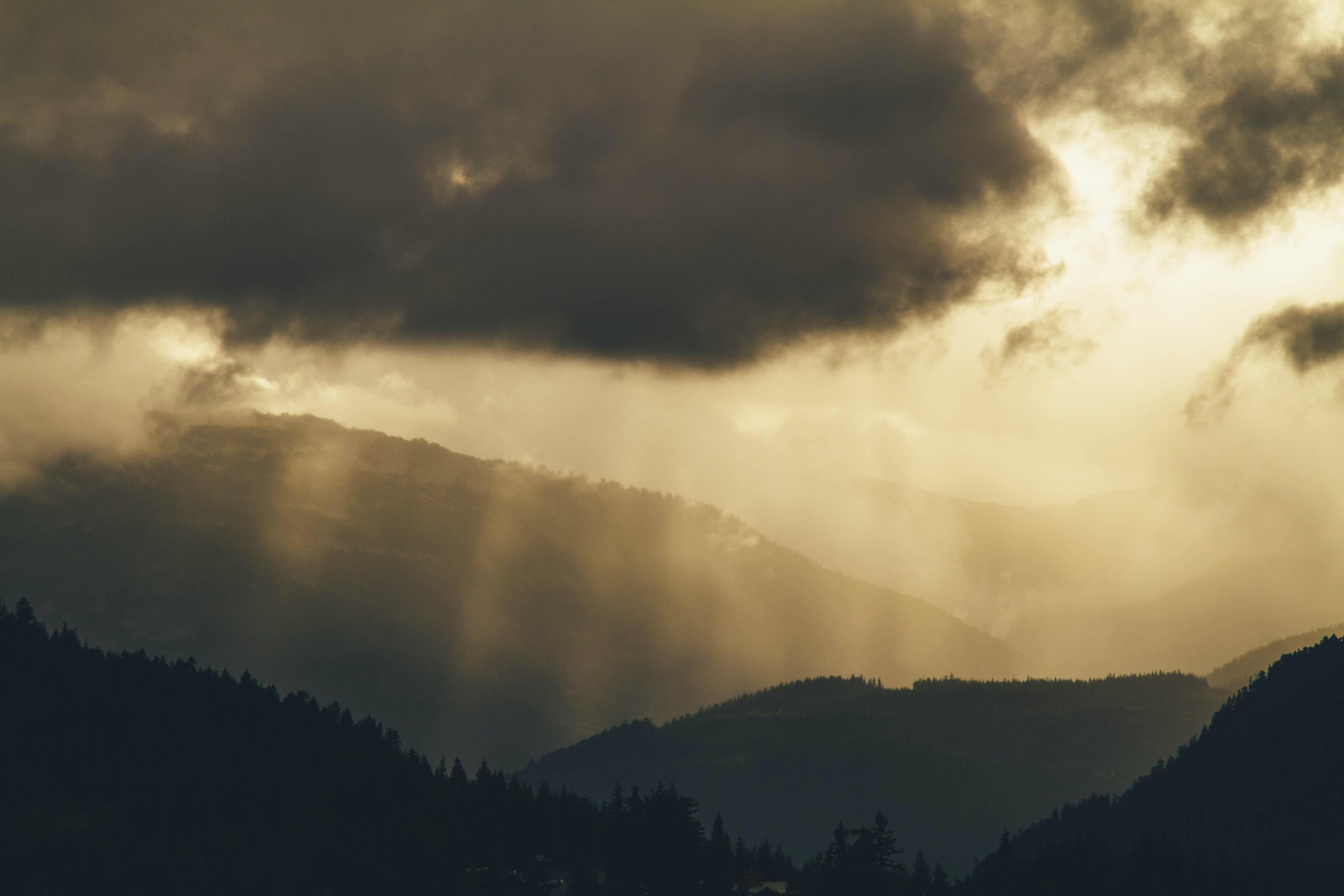 Faint sun rays over hills