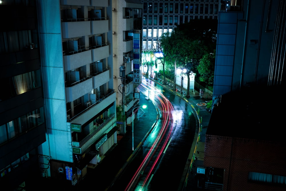 time lapse photography of cars along road