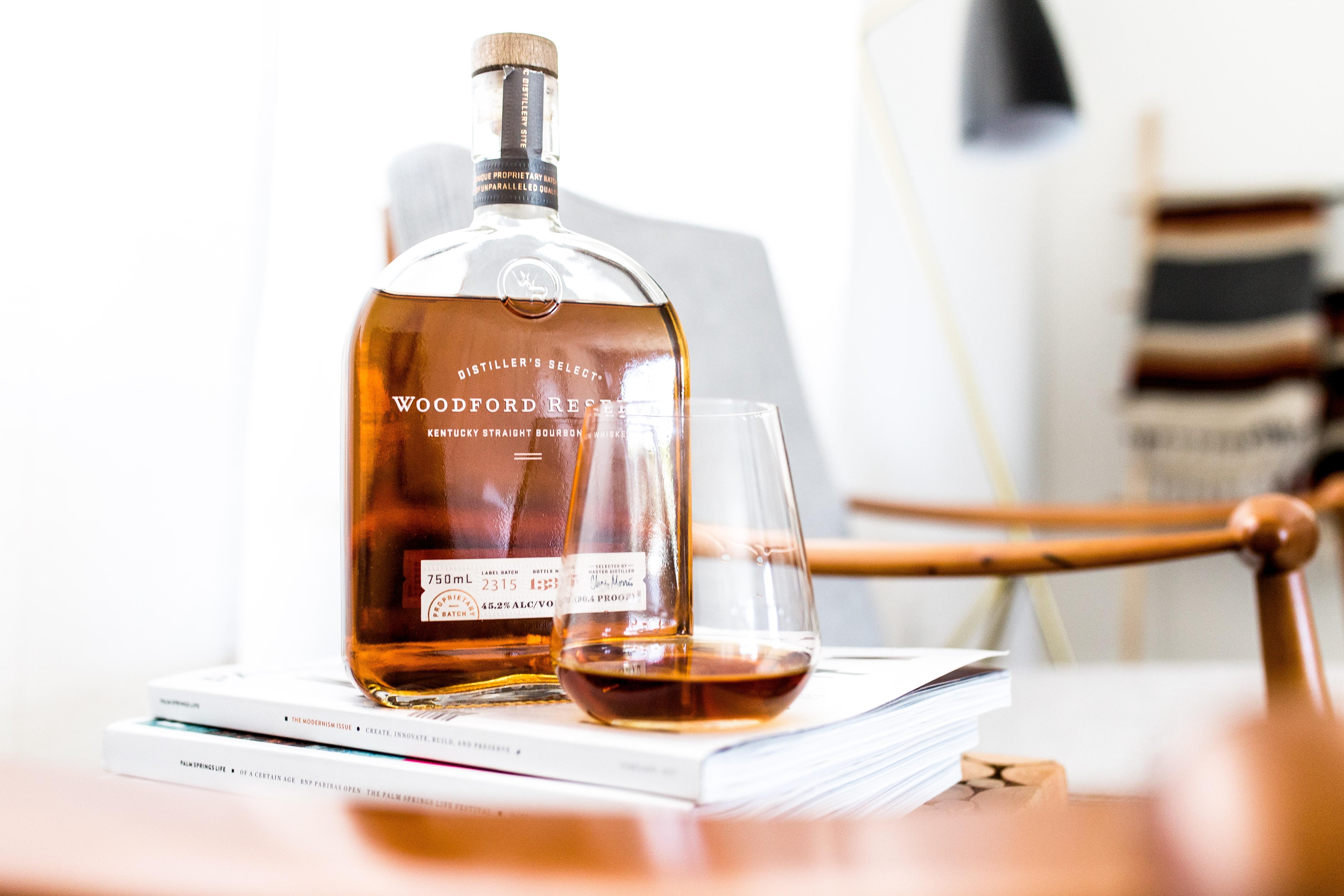 liquor bottle beside shot glass