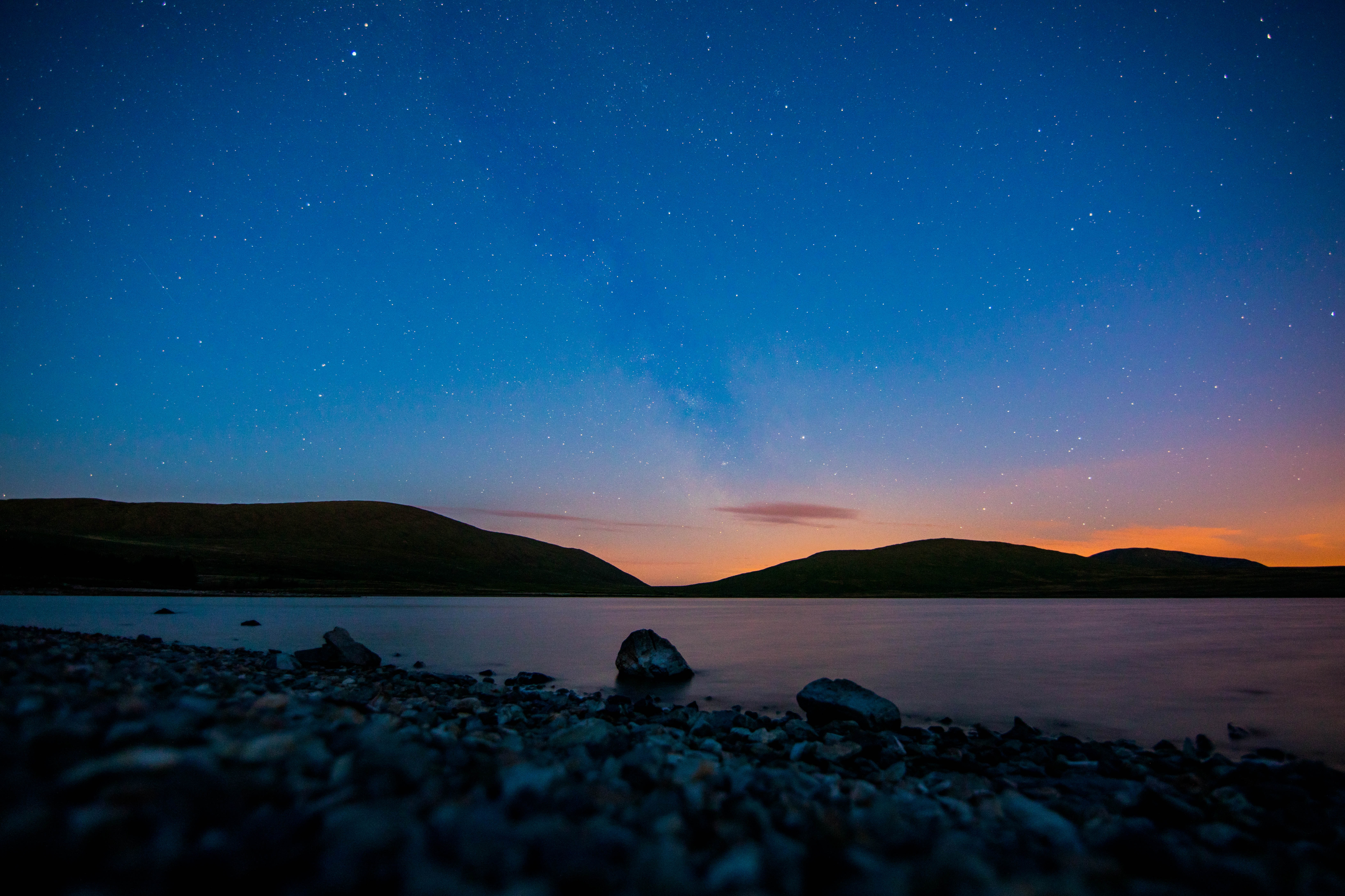 Starry sky over a rocky beach in the Mourne Mountains