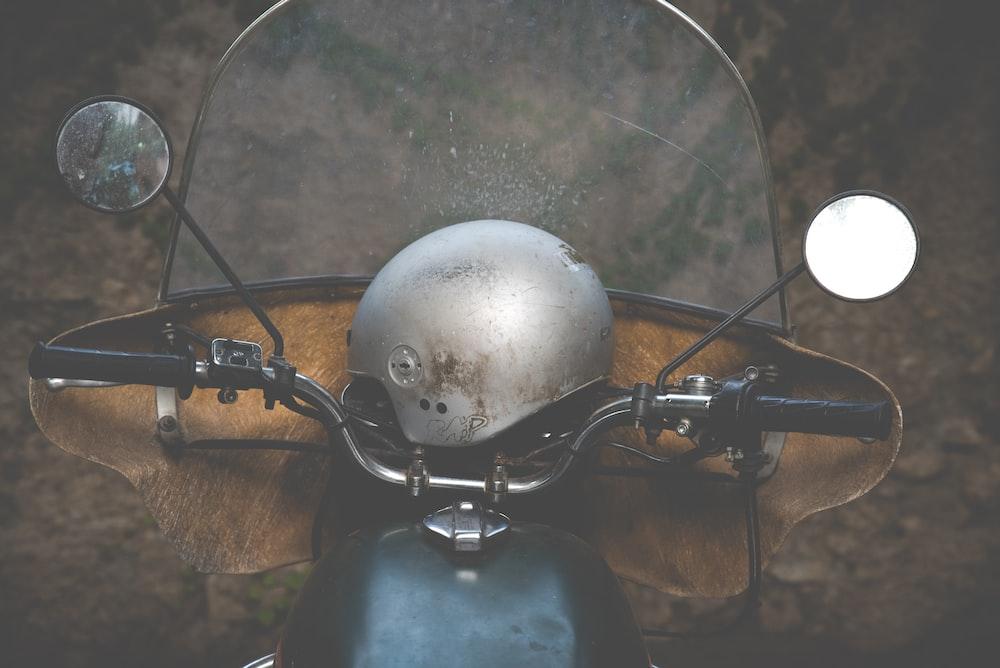 gray helmet on black motorcycle