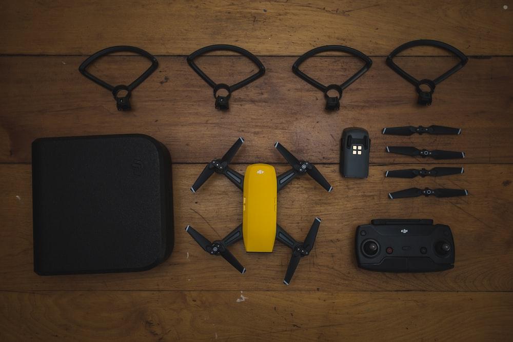 yellow DJI quadcopter set