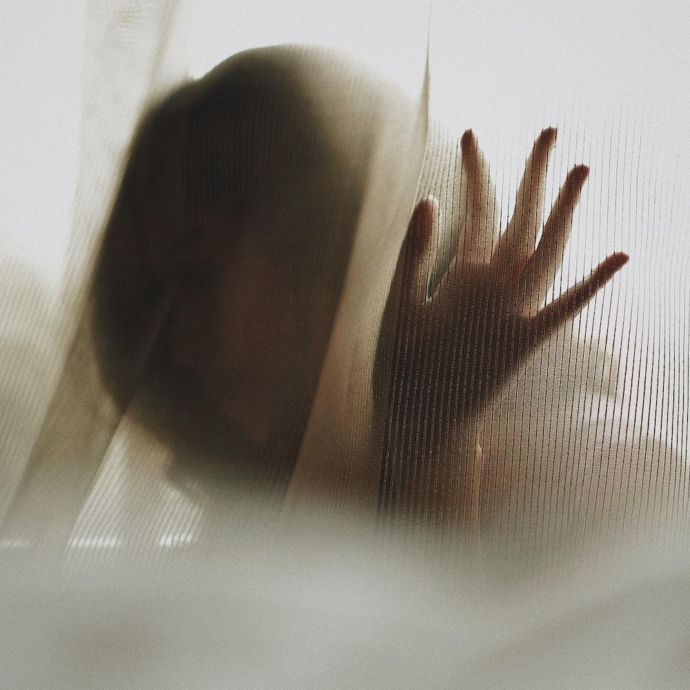 woman touching white textile
