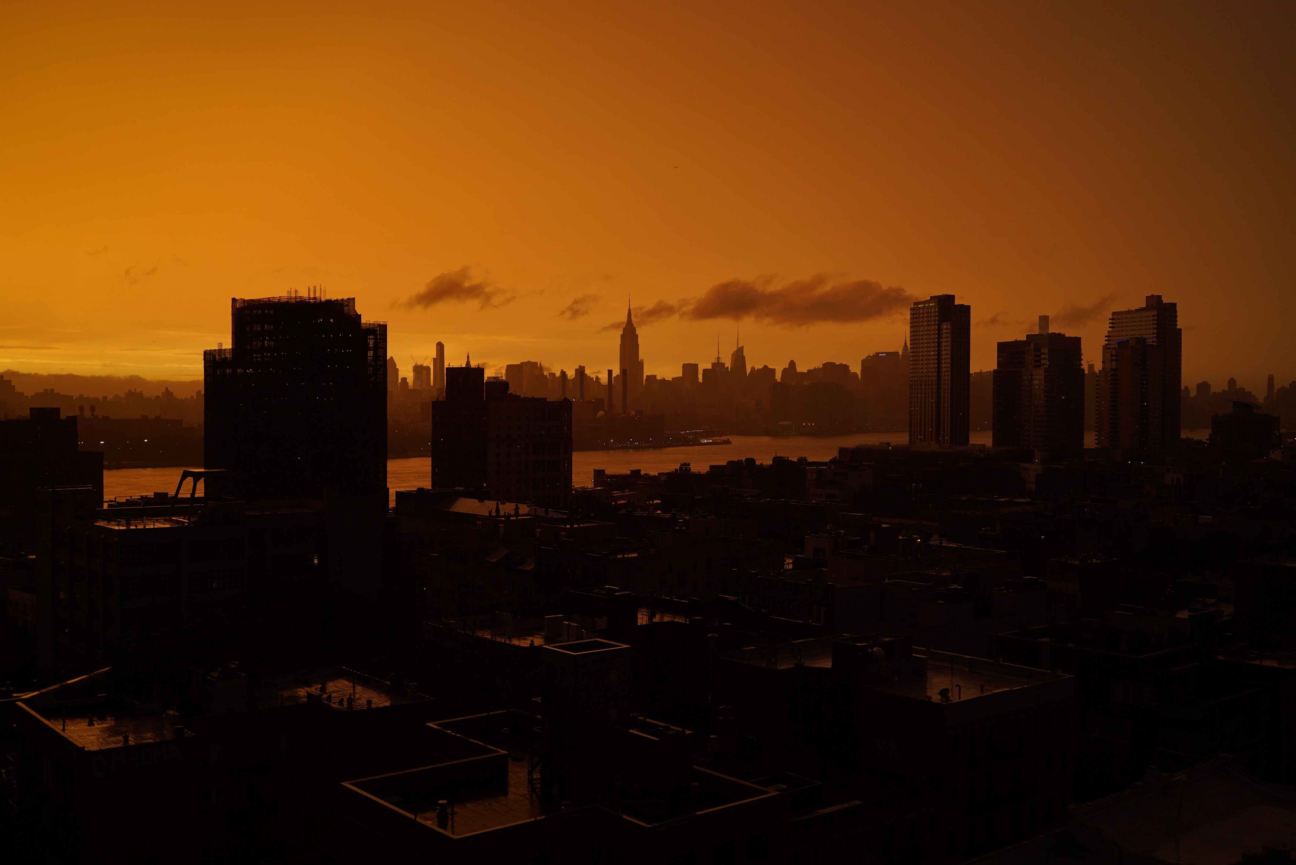 A dim skyline of Williamsburg at sunset