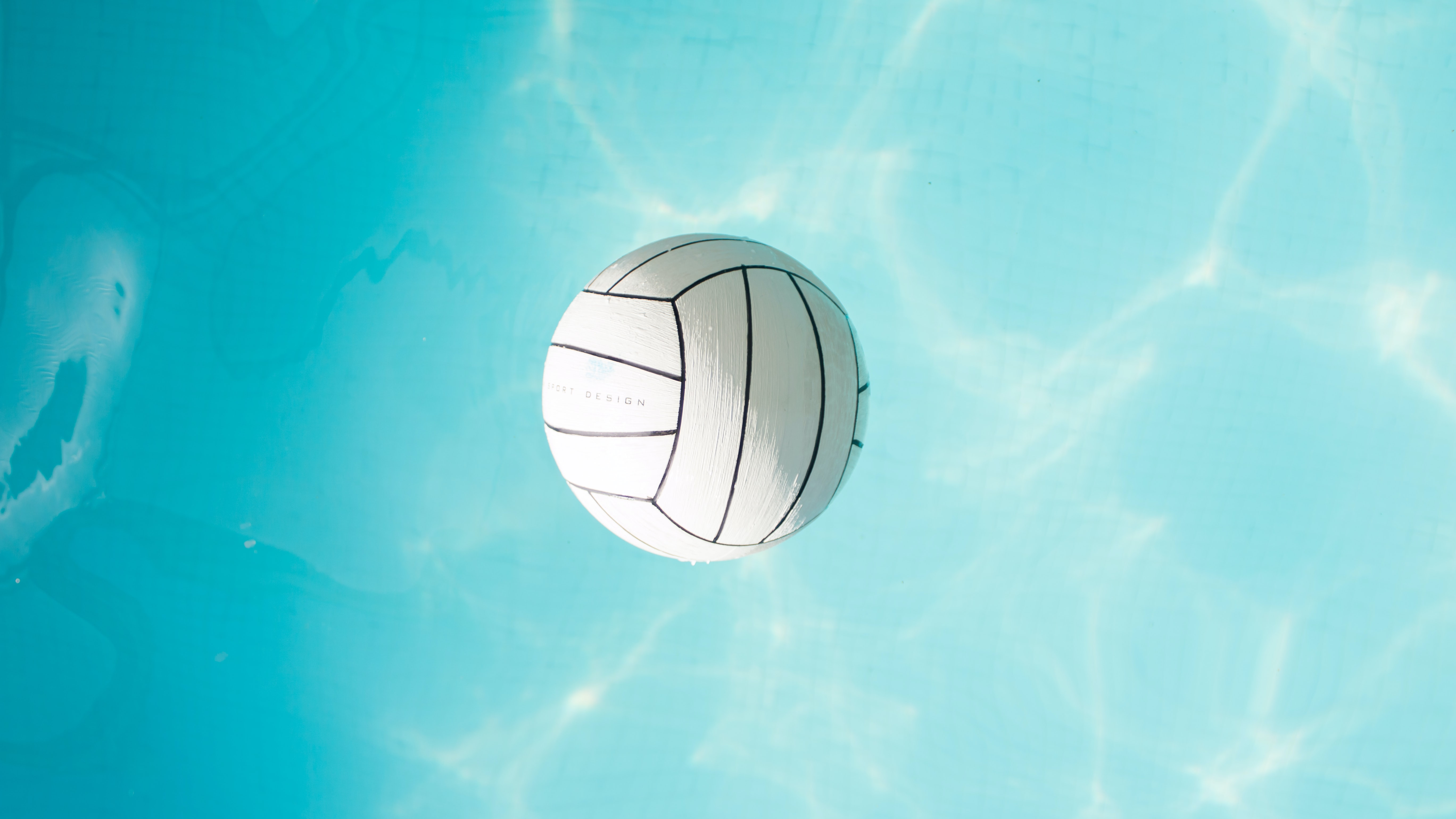 A white water polo ball floating in a swimming pool in Sopron