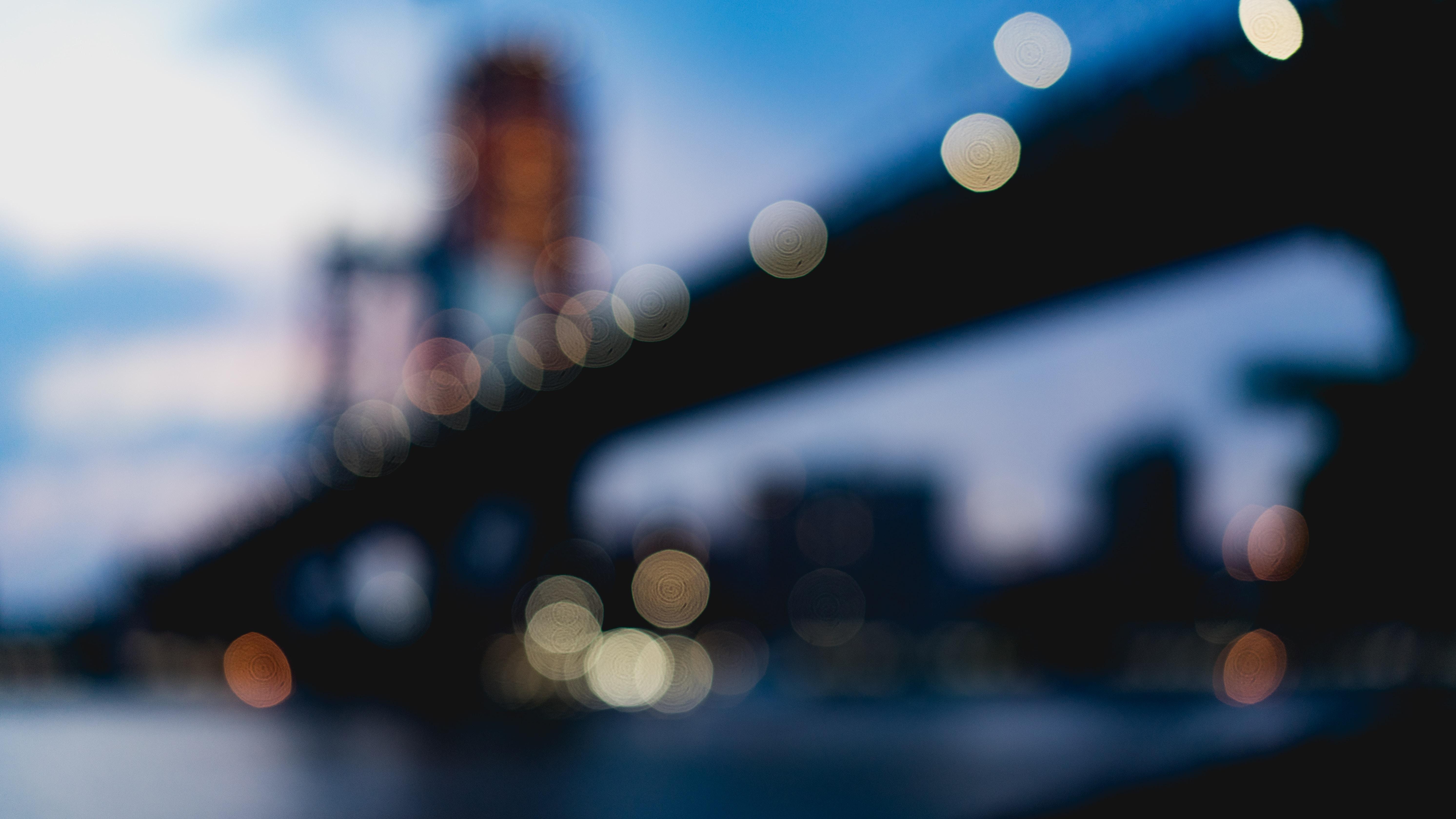 bokeh photography of suspension bridge