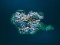 aerial view photography of island surrounded by ocean during daytime