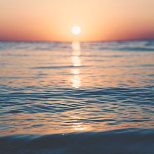 photo of ocean during golden hour