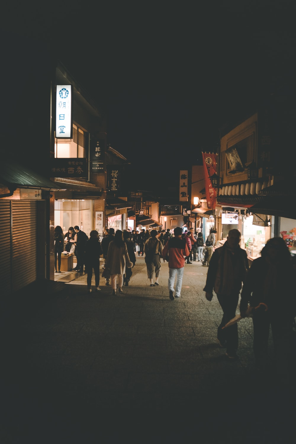 people walking on streets during nighttime