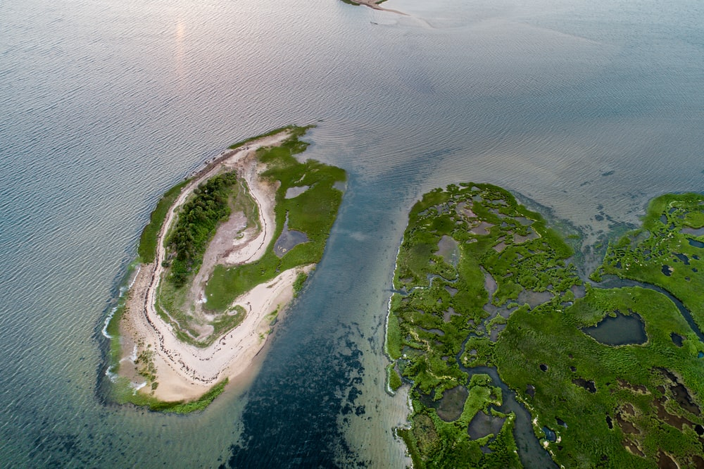 aerial view of island surrounded with body of water
