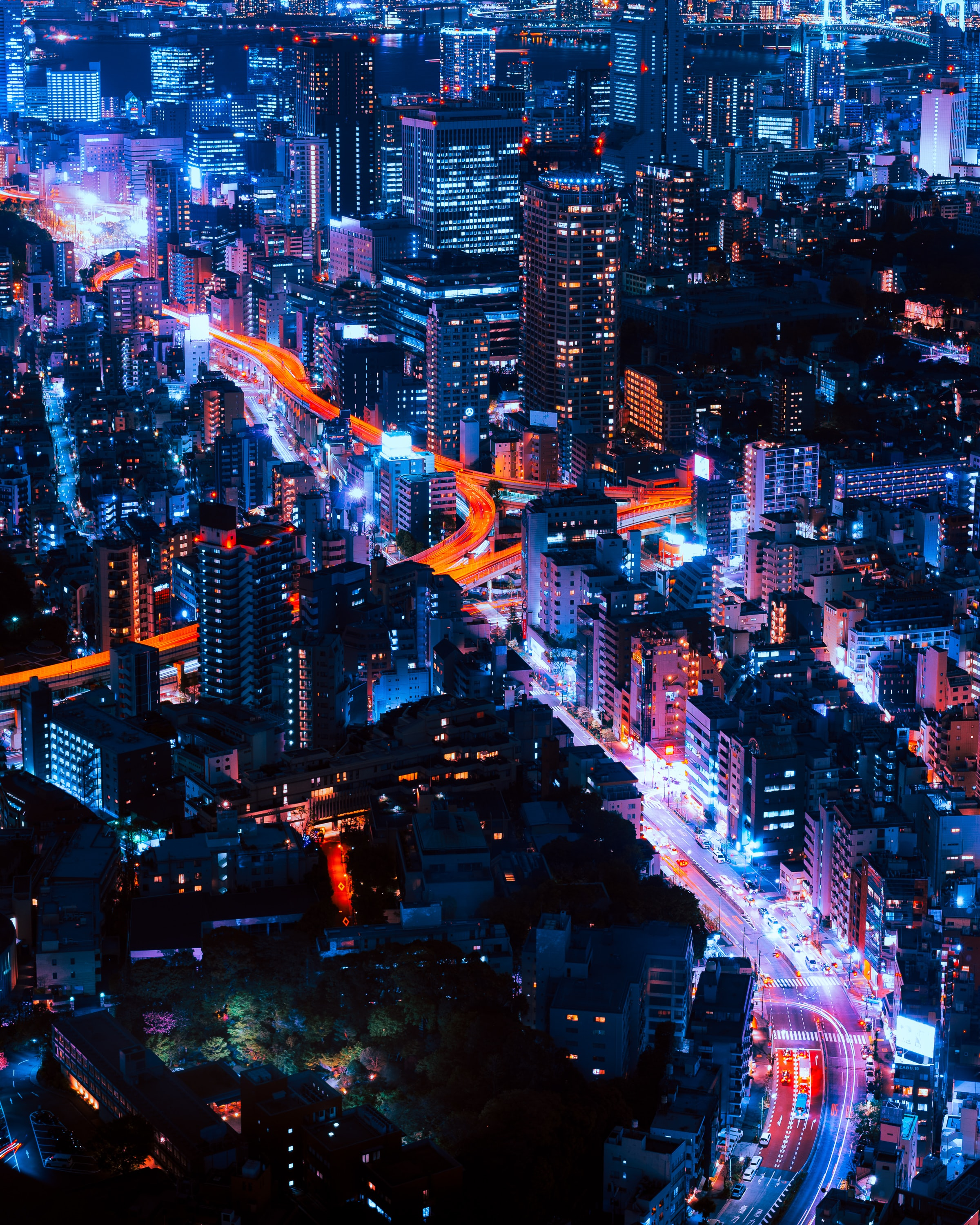Beautiful skyline of Tokyo with orange and blue lights illuminating its streets